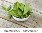 spinach in a white bowl on a... | Shutterstock . vector #639993307