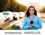 female news reporter on field... | Shutterstock . vector #640021135