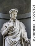 Small photo of Detail of the Dante Alighieri statue in Florence, Italy