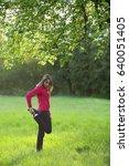 woman streching in green field