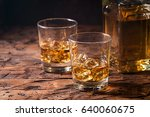 whiskey with ice in glasses on... | Shutterstock . vector #640060675