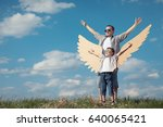 father and son playing with... | Shutterstock . vector #640065421