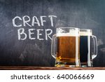 glasses of light and dark beer... | Shutterstock . vector #640066669