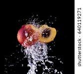 peach and half in water splash... | Shutterstock . vector #640119271