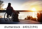 Woman In Wheelchair With Her...