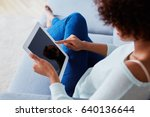 woman using her tablet sitting... | Shutterstock . vector #640136644