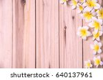 white plumeria on wooden... | Shutterstock . vector #640137961