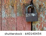 Old Metal Padlock On A Wooden...