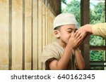 asian muslim kid kissing his... | Shutterstock . vector #640162345