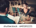couple reading menu in a... | Shutterstock . vector #640181221