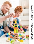 father and adorable son playing ... | Shutterstock . vector #640194991