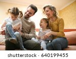 happy family at home spending... | Shutterstock . vector #640199455