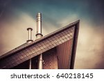 detail roof with 2 chimneys | Shutterstock . vector #640218145
