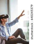 surprised man using vr headset   Shutterstock . vector #640245379