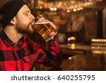 bearded young man enjoying... | Shutterstock . vector #640255795
