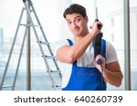 young worker with hand drill | Shutterstock . vector #640260739