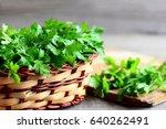 parsley sprigs in a wicker... | Shutterstock . vector #640262491