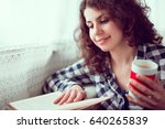 young brunette woman sitting on ...   Shutterstock . vector #640265839