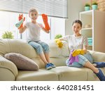 happy family cleans the room.... | Shutterstock . vector #640281451