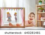 happy girl plays with... | Shutterstock . vector #640281481