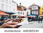 tourist holds in hand popular... | Shutterstock . vector #640285234