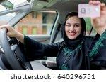 happy muslim woman driving car | Shutterstock . vector #640296751