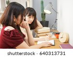 young woman studying with her... | Shutterstock . vector #640313731