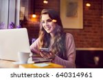 beautiful young woman working... | Shutterstock . vector #640314961