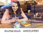 smiling woman texting on her... | Shutterstock . vector #640314985