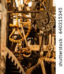 Small photo of Clockwork mechanism. Close up view of cog wheels and other mechanical parts of vintage tower clock.