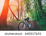 mtb cyclist in the forest... | Shutterstock . vector #640317631