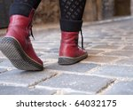 woman walking on pavement   red ... | Shutterstock . vector #64032175