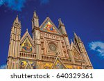 Small photo of Facade details of the opulent and monumental Orvieto Cathedral (Duomo) under sunny blue sky in Orvieto, a pleasant and well preserved medieval town. Located in Umbria, central Italy.