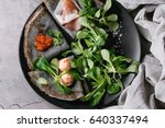 black pancakes crepes with... | Shutterstock . vector #640337494