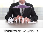insurer protecting a house  a... | Shutterstock . vector #640346215