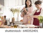 happy grandma cracking an egg... | Shutterstock . vector #640352401