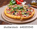 sliced pepperoni pizza with... | Shutterstock . vector #640355545