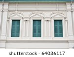 Thai old wooden green window with white wall - stock photo