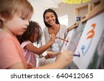 teacher at montessori school... | Shutterstock . vector #640412065