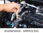 man hand checking car oil level ... | Shutterstock . vector #640421161