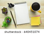 notebook on office table with a ... | Shutterstock . vector #640451074