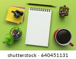 notebook on office table with a ... | Shutterstock . vector #640451131