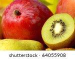 Mango and kiwi fruits. - stock photo