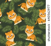tiger cub in tropical leaves.... | Shutterstock .eps vector #640562977