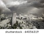 Tree stumps with gray sky - stock photo