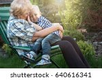 little boy sitting on the arms...   Shutterstock . vector #640616341