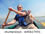 father and son paddling a canoe ... | Shutterstock . vector #640617451