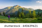 tourist looking at mountain...   Shutterstock . vector #640639621