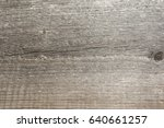 Small photo of The relief texture of the surface of the old wooden board with poor processing, the expressive direction of the wood fibers and the cutoff point of the knot