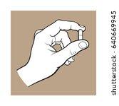 hand holding two piece gelatin... | Shutterstock .eps vector #640669945